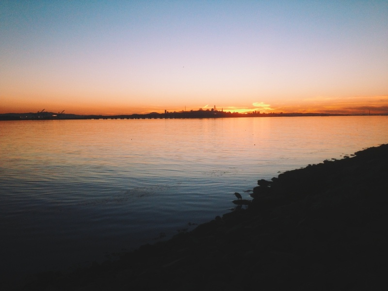 A view of the sunset over the Bay from Marina Park in Emeryville, California.